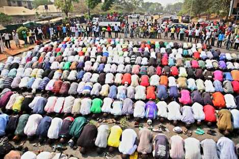 Muslims pray while Christians form a protective human chain around them during a protest against the elimination of a popular fuel subsidy that has doubled the price of petrol in Nigeria's capital Abuja